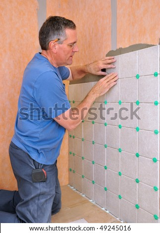 Ceramic Tile Bathroom on Man Installing Ceramic Tile In Shower Area Of Bathroom Stock Photo