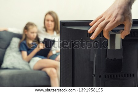 Man installing conditional access module card to TV. Stock fotó ©