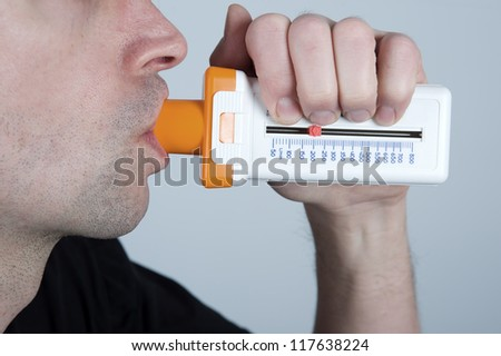 man is checking his pulmonary function