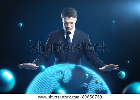 Man is controlling the earth models. Young business man with planet system around him. Conceptual image of technology global communication