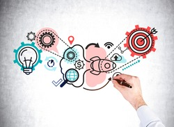 Man is drawing sketch on concrete wall with icons of light bulb, cogwheel, launched rocket, dollar, data cloud, human resources. Concept of relationship between different parts of business structure