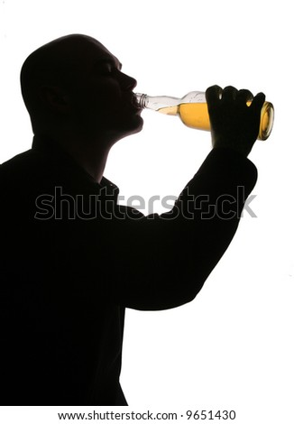 Man is drinking bottle of alcohol