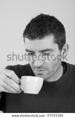 man is drinking coffee