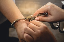 Man is handcuffed. The concept of theft prevention
