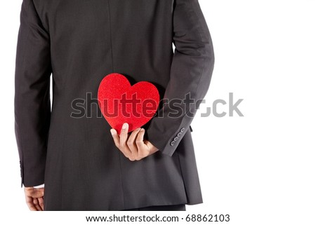 Man is hiding his valentine gift. - stock photo
