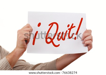 "Man is holding a piece  of  white paper, ""I Quit"" printed on the paper."