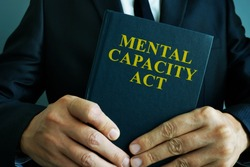 Man is holding mental capacity act.