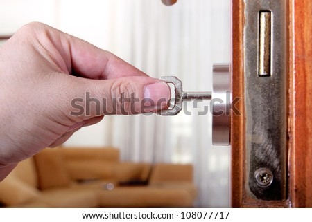 man is locking or unlocking a door