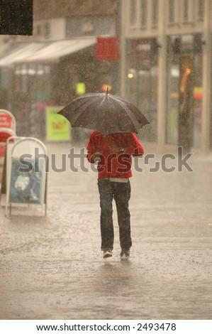 Man is running in the rain. Motion blur.