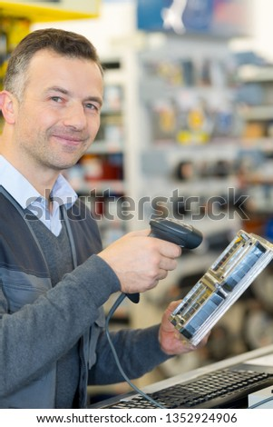 man is scanning by handheld device #1352924906