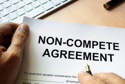 Man is signing Non compete agreement
