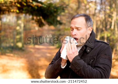 Man is sneezing