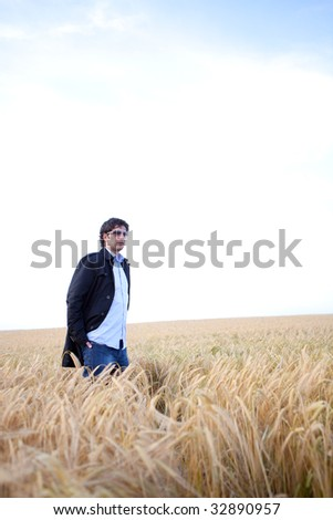 Man is standing in a cornfield