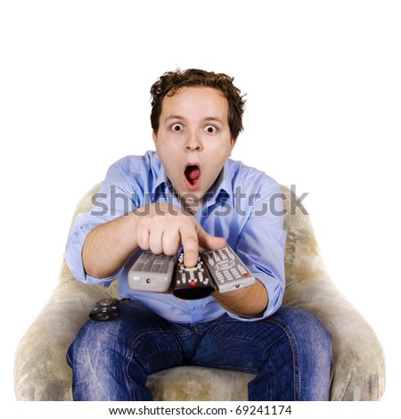 Man is switching channels - stock photo
