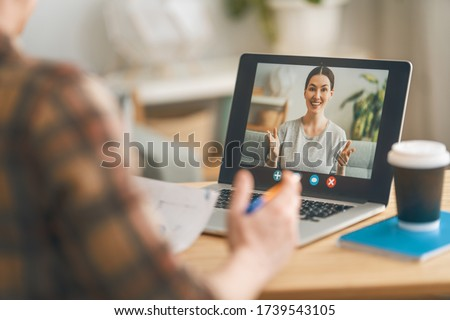 Man is using laptop pc for remote conversation and video call.  Foto stock ©