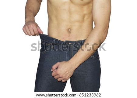 Man jeans loose after fitness isolated on white #651233962
