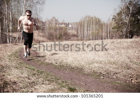 Man jogging outdoors, blurred motion