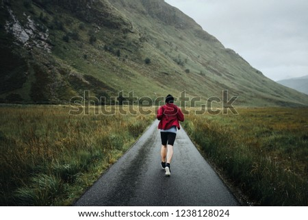 Man jogging through the Highlands #1238128024