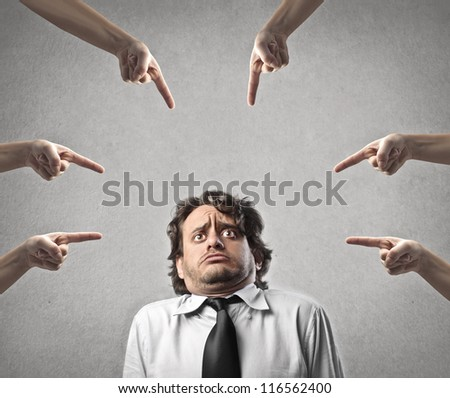 Man judged by different hands - stock photo