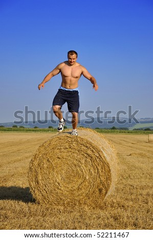 Man jump down from bale straw