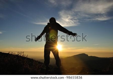 Man jump on sunrise scene