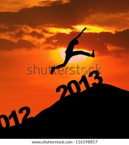 Man jump over 2013 number to embrace the new year