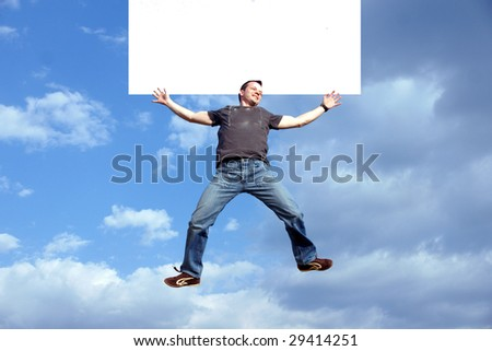 man jumping against blue sky  with white banner
