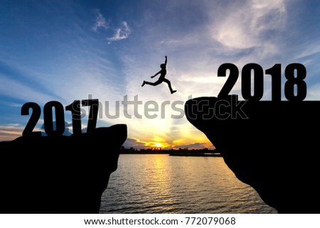 man jumping from 2017 to 2018 #772079068