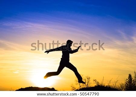 Man jumping in the sunset.