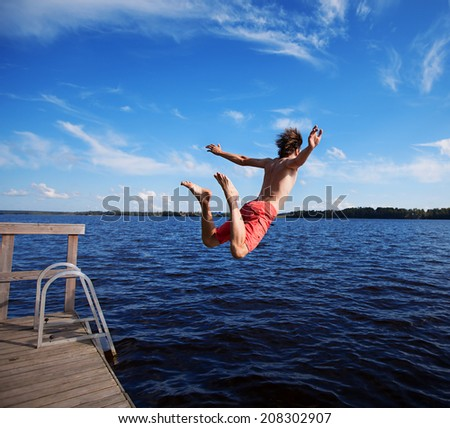 Man jumping off jetty.