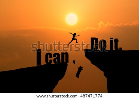 Man jumping on I can do it or I can't do it text over cliff on sunset background,Business concept idea Stockfoto ©