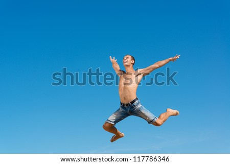 man jumping on the blue sky background, a good time