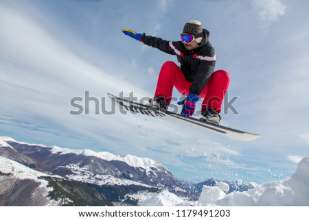 Man jumping with snowboard #1179491203