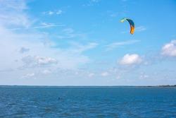 Man kite surfing on the ocean at Assateague Island National Seashore
