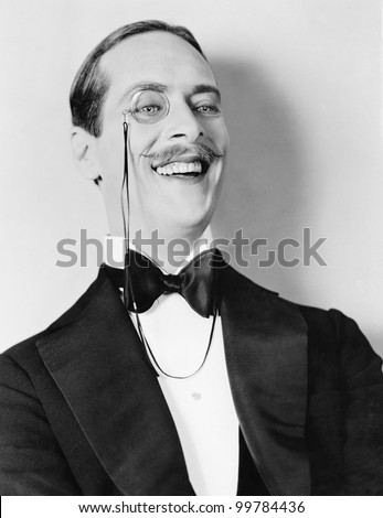 Man laughing and a monocle