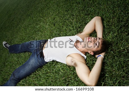 Man laying on grass #16699108