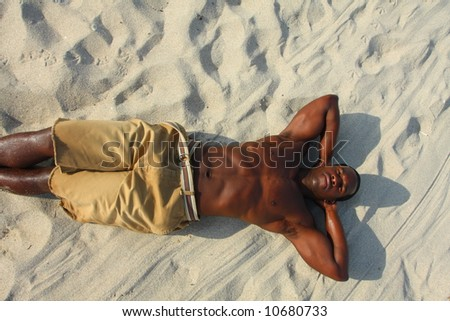 Man Laying On The Sand