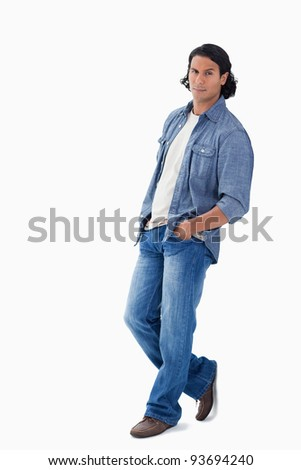 man leaning against a wall with white background