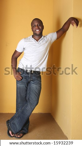 Man Leaning On A Yellow Wall