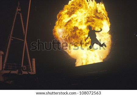 Man leaping through fireball, Miami, Florida