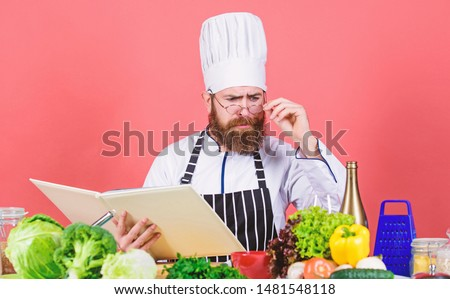 Man learn recipe. Try something new. Cookery on my mind. Cooking skill. Book recipes. According to recipe. Man bearded chef cooking food. Check if you have all ingredients. Cook read book recipes.