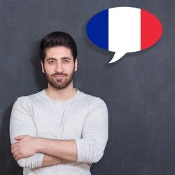 Man learn speaking french in bubble on chalkboard