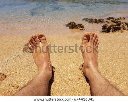 Man legs against sea and sandy beach #674416345