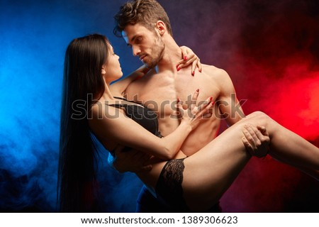 man lifting his woman and going to bed with her. close up photo #1389306623