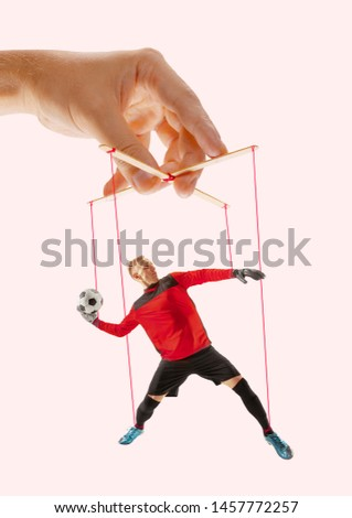 Man like a puppet in somebodies hands on pink background. Concept of unfair manipulation, phycology of exploitation, mental technique, motivation. Puppets and their masters. Possessive relationship. #1457772257