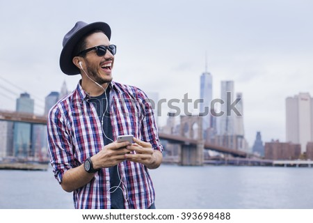 Man listening music with his smartphone in Brooklyn, New York