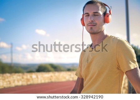 Man listening to music #328942190