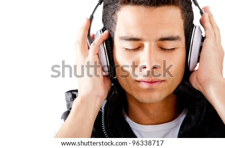 Man listening to music and relaxing - isolated over a white background - stock photo