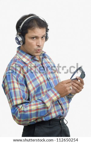 Man listening to music and whistling