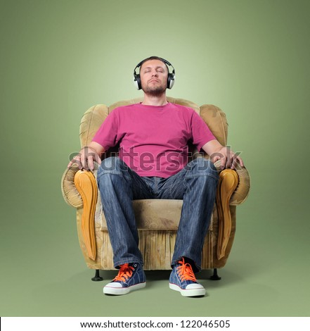 Man listening to relaxing music while sitting in a chair